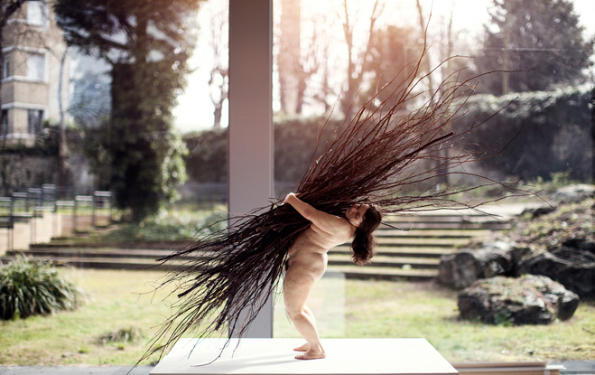 Woman with Sticks. Ron Muek.